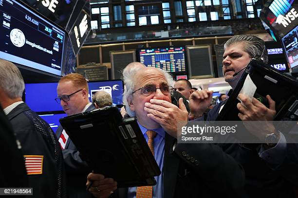 Traders work on the floor of the New York Stock Exchange the morning after Donald Trump won a major upset in the presidential election on November 9...