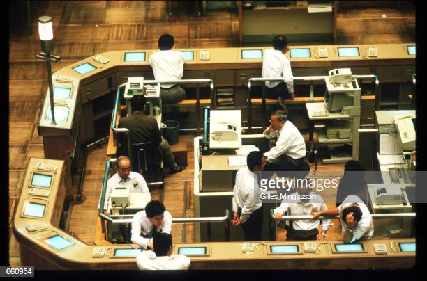 Traders work on the floor of the Tokyo Stock Exchange September 1 1998 in Tokyo Japan The TSE which has a monthly trade volume of 8000 billion yen is...