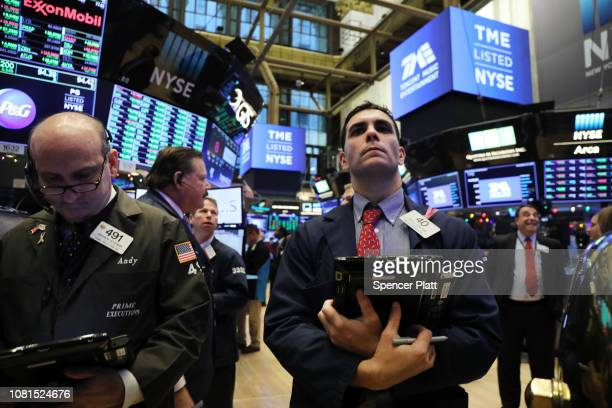 Traders work on the floor on the New York Stock Exchange as the Chinese music-streaming service Tencent Music launches its IPO on December 12, 2018...