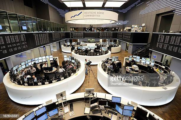 Traders work on the trading floor of the Frankfurt Stock Exchange on February 25 2013 in Frankfurt am Main Germany The German Stock Market Index DAX...