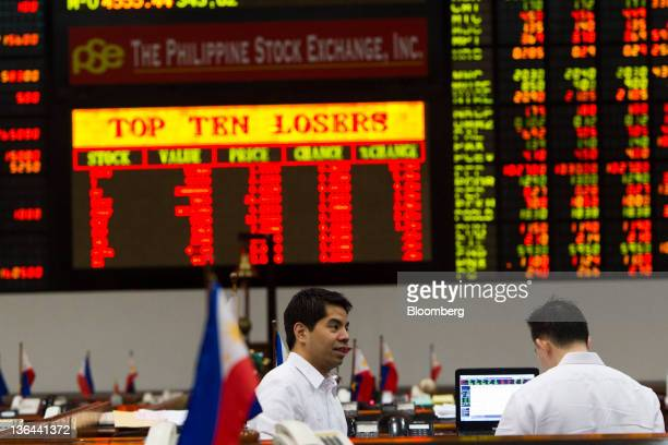 Traders work on the trading floor of the Philippines Stock Exchange in Makati City in Manila the Philippines on Tuesday Jan 4 2012 Philippine...