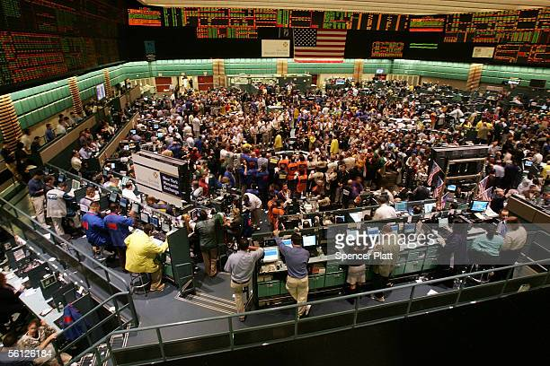 Traders work the floor of the New York Mercantile Exchange November 9 2005 in New York City Following a report that inventories of crude and gasoline...