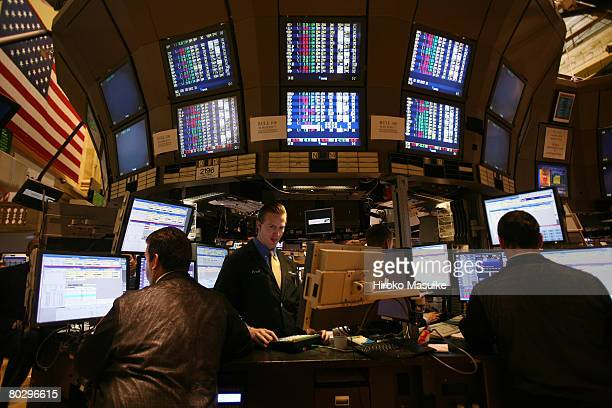 Traders work the floor of the New York Stock Exchange after the Fed board rate decision was announced March 18 2008 in New York City Stocks held on...