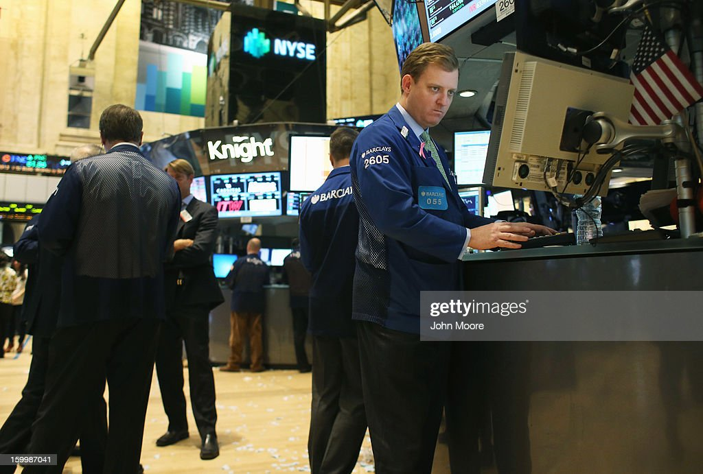 Traders work the floor of the New York Stock Exchange at the end of the trading day January 24, 2013 in New York City. The Dow Jones Industrial Average and the S&P both hit 5-year highs January 24, with the Dow closing at 13,825.