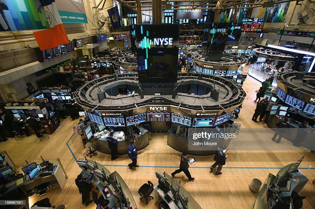 Traders work the floor of the New York Stock Exchange at the end of the trading day on January 24, 2013 in New York City. The Dow Jones Industrial Average and the S&P both hit 5-year highs January 24, with the Dow closing at 13,825.