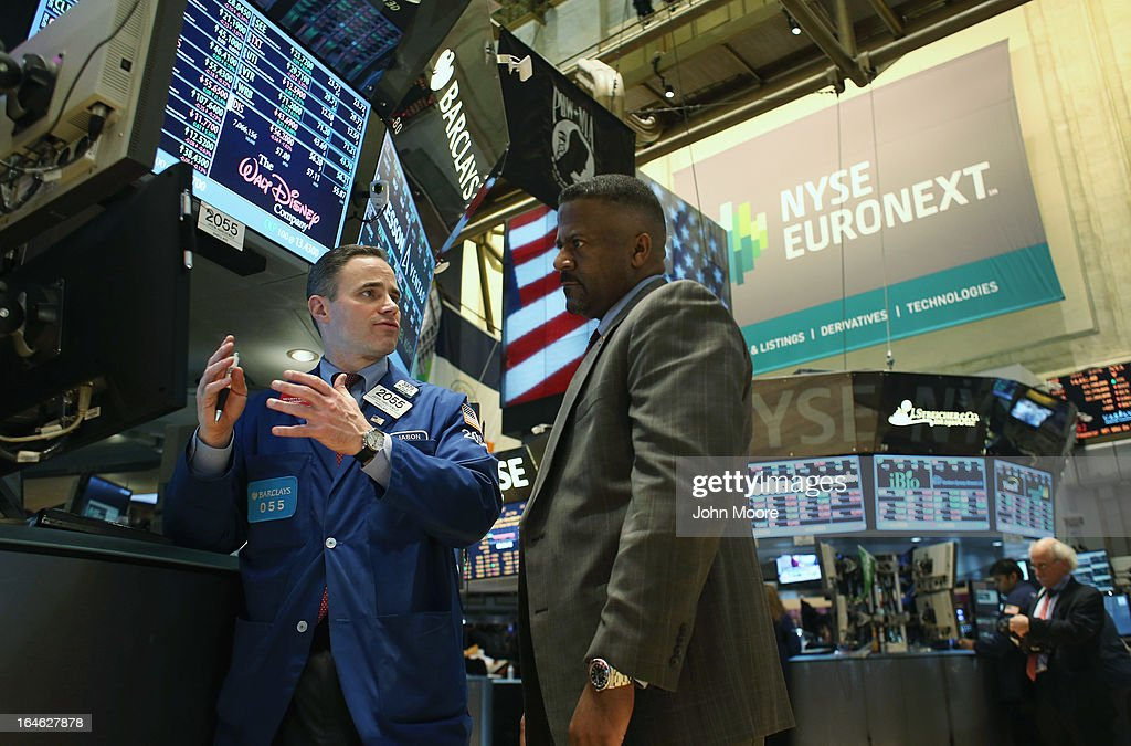 Traders work the floor of the New York Stock Exchange during late trading on March 25, 2013 in New York City. The Dow Jones Industrial Average closed down 64 points amid renewed worries about Cyprus.