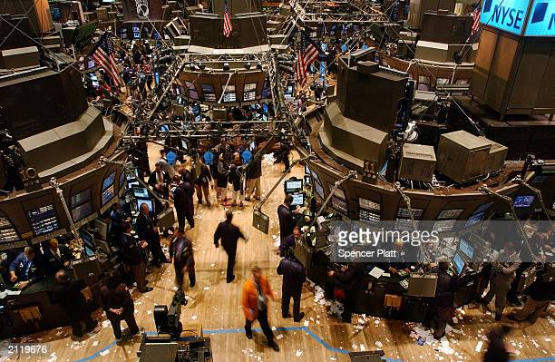 Traders work the floor of the New York Stock Exchange June 27 2003 in New York City US stocks fell today after afternoon selling undermined an early...