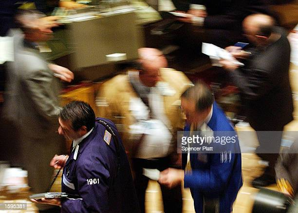 Traders work the floor of the New York Stock Exchange November 6 2002 in New York City The Dow Jones industrial average rose 9274 or 11 percent to...