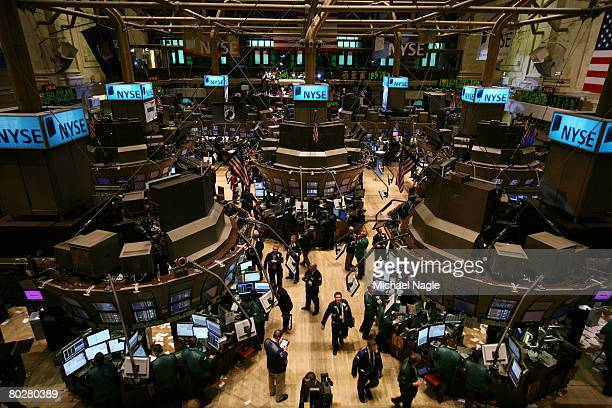 Traders work the floor of the New York Stock Exchange on March 17 2008 in New York City Stocks have been volatile on Wall Street following news of JP...