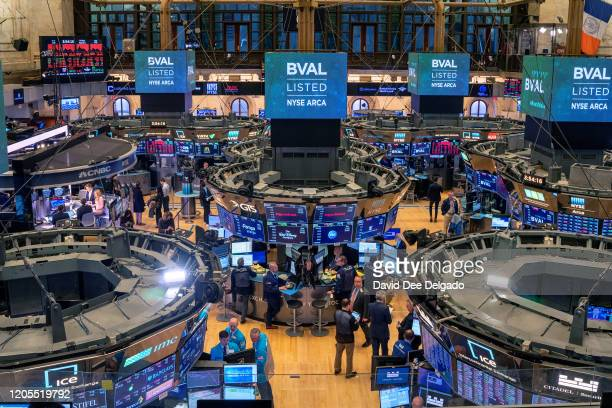 Traders work the floor of the New York Stock Exchange on March 6, 2020 in New York City. Stocks fell for a second day as investors seek refuge in...