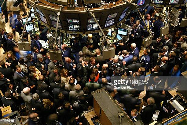 Traders work the floor of the New York Stock Exchange September 17 2003 in New York City the day after Richard Grasso the head of the NYSE resigned...