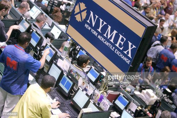 Traders work the oil pit at the New York Mercantile Exchange June 8 2006 in New York City World oil prices fell under $70 per barrel following news...