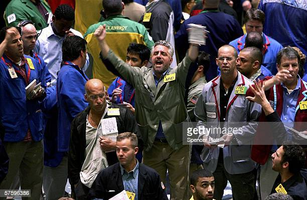 Traders work the pit on the floor of the New York Mercantile Exchange May 12 2006 in New York City Oil prices have yet to be effected after a...