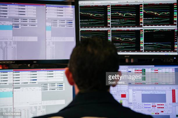 Traders work through the closing minutes of trading Tuesday on the New York Stock Exchange floor on February 25, 2020 in New York City. Fueled by...