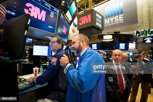 Traders work under monitors displaying 3M Co signage on the floor of the New York Stock Exchange in New York US on Monday Oct 23 2017 US stocks got...