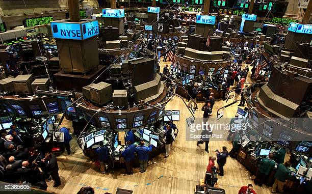 Traders works on the floor of the New York Stock Exchange August 15 2008 in New York City Stocks were up in morning trading on Wall Street as the...