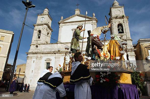 Tradesman push a float with the Veronica in front of the cathedral for the procession April 8 2004 in Caltanissetta Sicily The floats hold statues...
