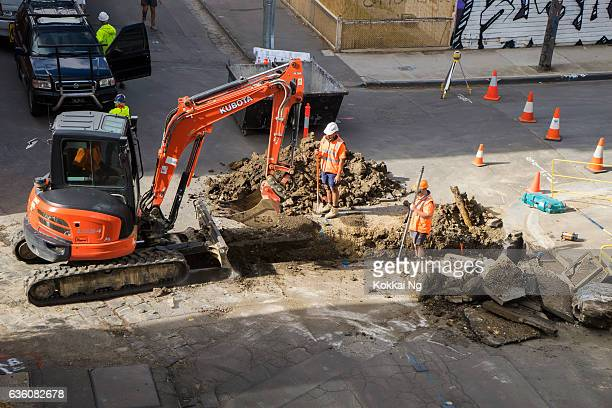 Tradesmen digging a hole in Melbourne
