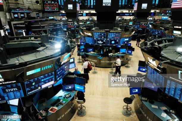 Trading ends for the day on the floor of the New York Stock Exchange on March 20, 2020 in New York City. Trading on the floor will temporarily become...