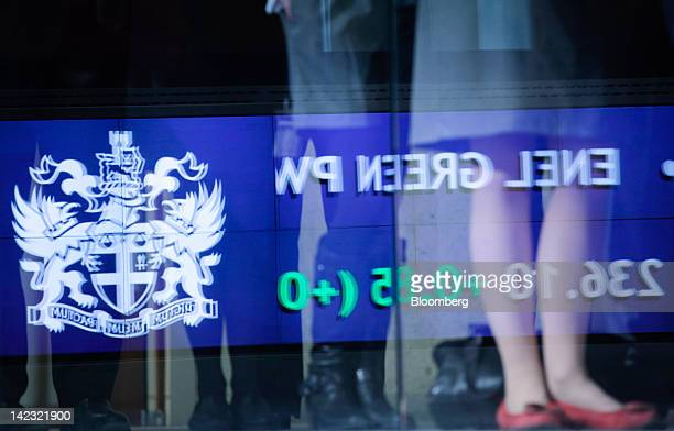Trading figures are seen reflected on a staircase in the main entrance of the London Stock Exchange Group Plc's headquarters as the company holds its...
