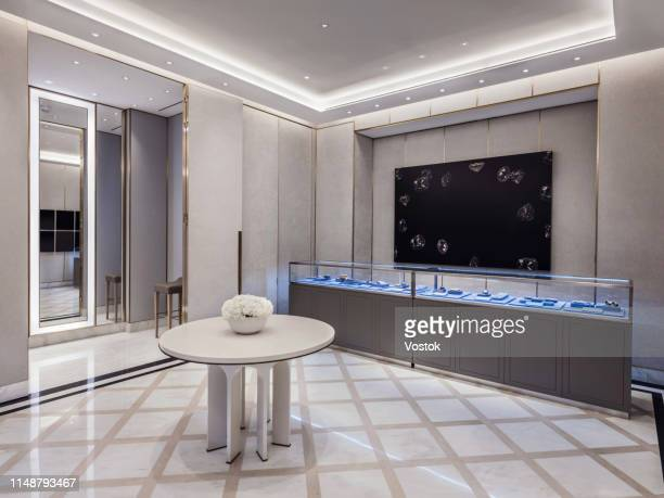 trading hall with diamonds in jewellery store - jewelry store stock pictures, royalty-free photos & images