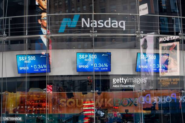 P 500 trading screens are displayed at the Nasdaq building in Times Square as the city continues Phase 4 of reopening following restrictions imposed...