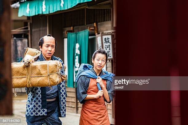 tradional japanese father and son farmers taking produce to market - lypsekyo16 stock pictures, royalty-free photos & images