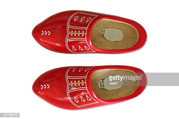 Tradional red Dutch wooden shoes, topview isolated on white
