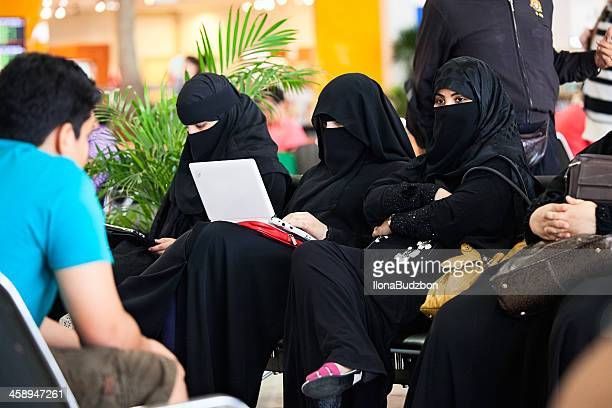 tradition and modernity - burka stock photos and pictures