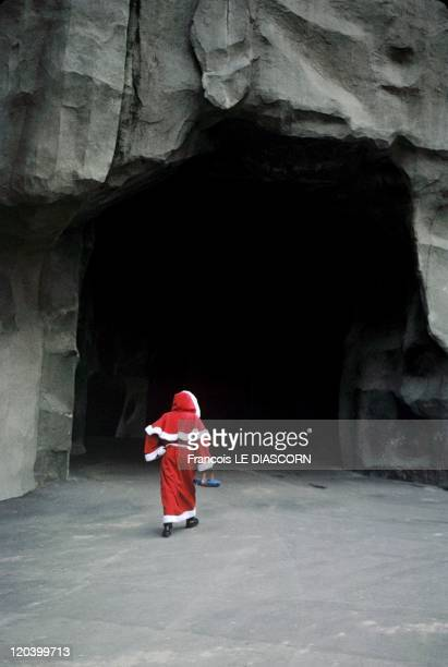 Tradition of Santa Claus in Paris France in December 1998 A child Santa Claus in a cave Vincennes Zoo