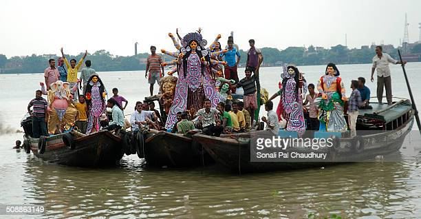 Tradition of taking Idol Goddess Durga and her entourage across river Hooghly in Kolkata.The journey is from Kumartuli to Belur.Carrying forward the...