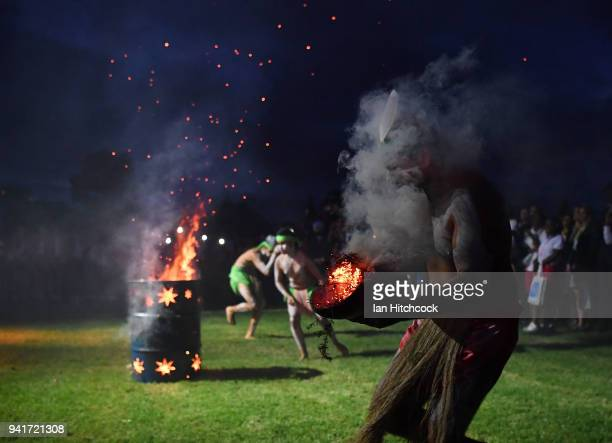 Traditional Aboriginal dancers are seen performing a 'Welcome to Country' ceremony with athletes at Jezzine Barracks during an official welcome...