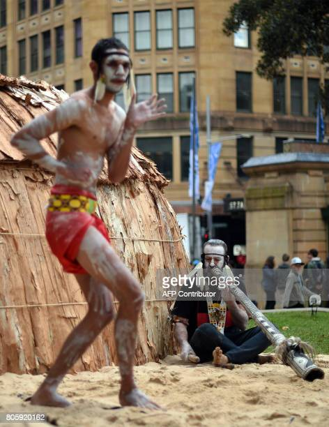 Traditional Aboriginal dancers perform at Sydney's Hyde Park on July 3 2017 The week long annual event with the theme of 'our languages matter'...