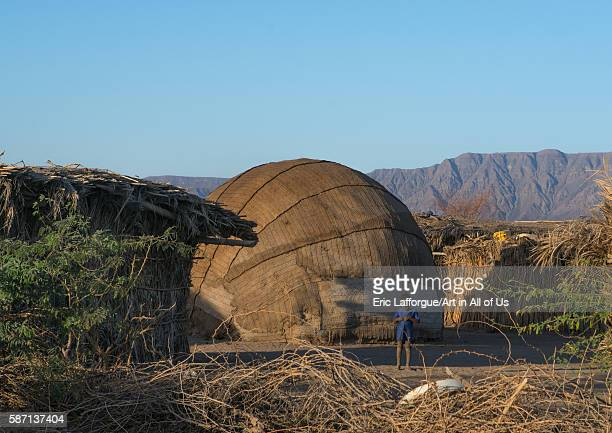 Traditional afar tribe village with ovalshaped huts afar region afambo Ethiopia on March 1 2016 in Afambo Ethiopia