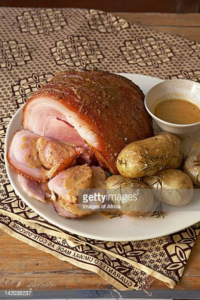 Traditional African cooking. Gammon with honey and mustard glaze