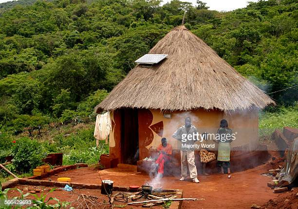 Traditional African hut with a solar panel on the thatch roof Venda Limpopo Province South Africa