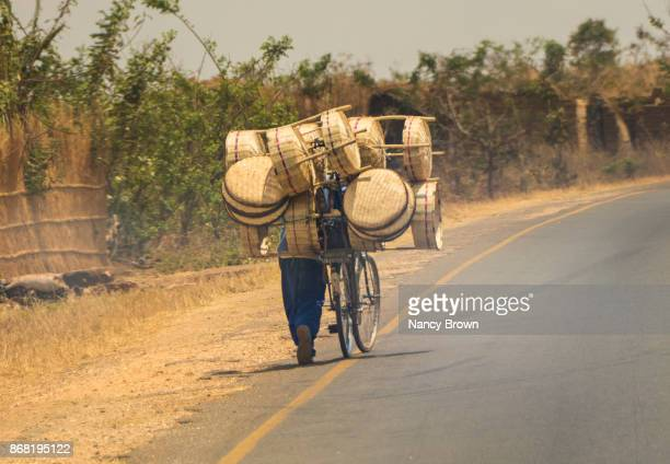 Traditional African Man & Traditional Transportation on Road in Malawi.