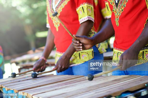 traditional african marimba player hands playing wooden xylophone outdoors - percussion mallet stock pictures, royalty-free photos & images