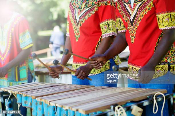 traditional african marimba players hands playing wooden xylophone outdoors - music style stock pictures, royalty-free photos & images