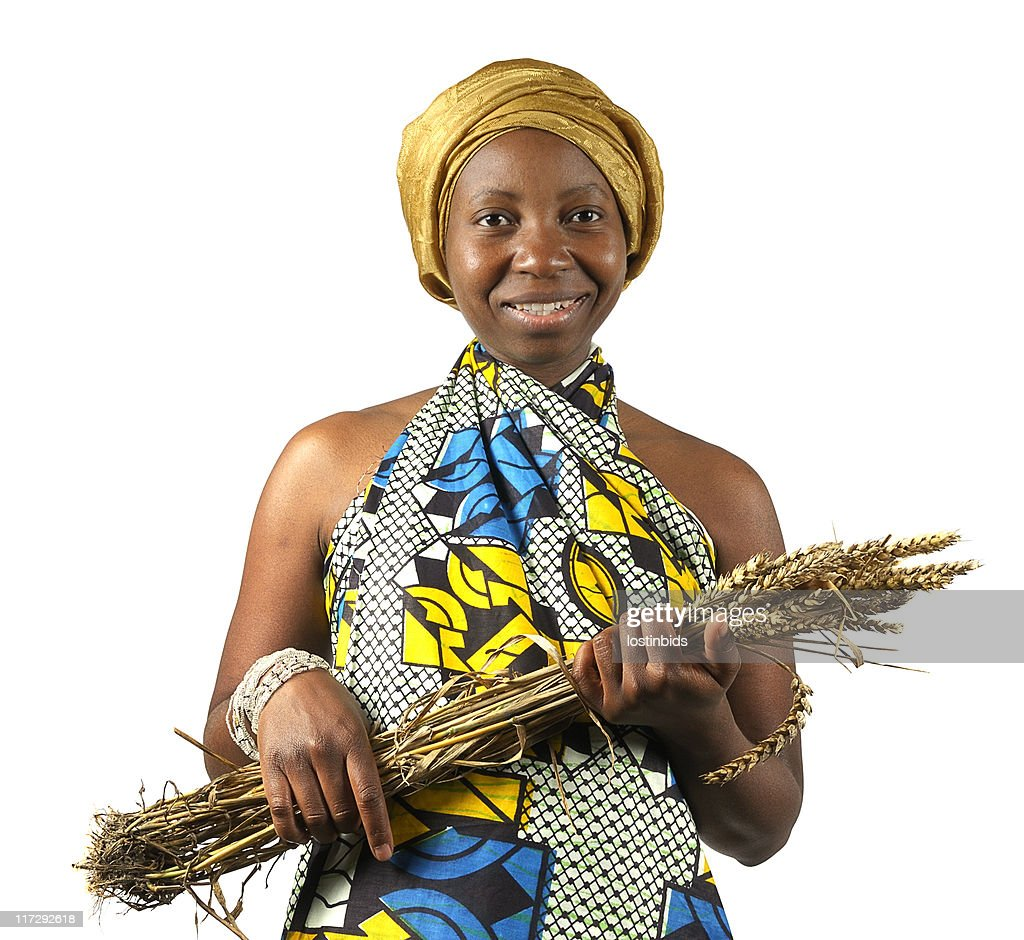 Traditional African Woman Holding her Wheat : Stock Photo