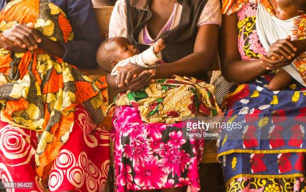 Traditional African Women & Babies Sitting in Village of Sellima in Malawi.