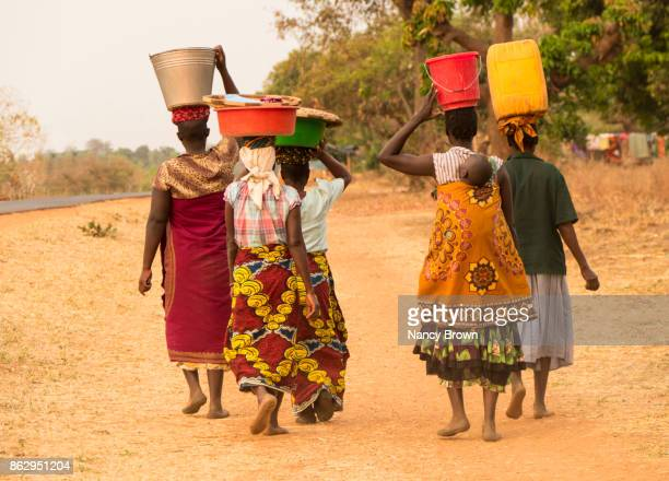 Traditional African Women Walking by Road in Village of Salima in Malawi.