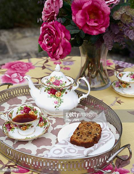 Traditional afternoon tea and cake on silver tray