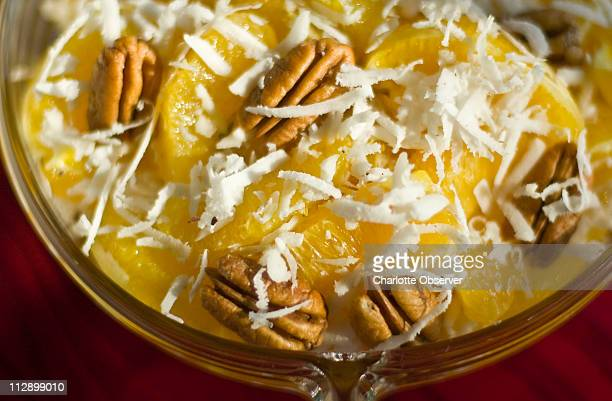 A traditional ambrosia with orange slices pecans and grated coconut