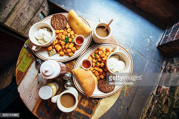 Traditional American breakfast served on the table, high angle view