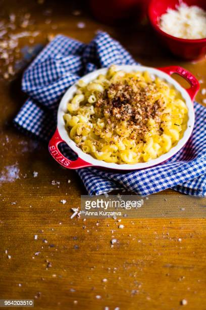 traditional american food. baked macaroni and cheese also called mac and cheese on a wooden table, top view. comfort food. hearty food. - course meal stock pictures, royalty-free photos & images