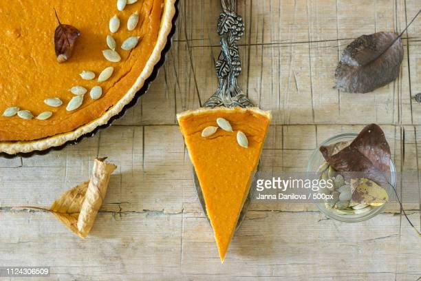 Traditional American Pumpkin Pie For Thanksgiving Day Or Halloween On A Wooden Background. Rustic...