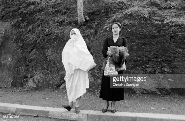 Traditional and contemporary dress styles worn by two women in the Casbah of Algiers