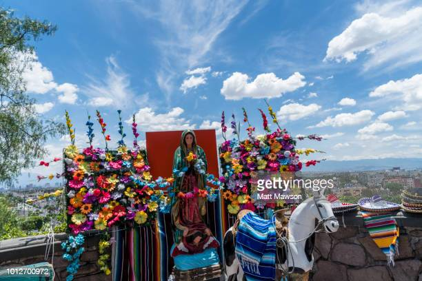 traditional and religious tourist knick knacks for sale near the guadalupe basilica in mexico city - pilgrimage stock pictures, royalty-free photos & images