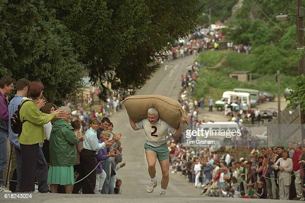 Traditional annual wool sack race test of strength in Tetbury Gloucestershire World Culture